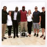 VMSI's Kylene Henson (right) and Megan Shelton  pose with Redskins players.