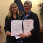 Kathy McKenzie (left) presents  Dana Ebersole with an Award of Excellence