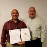 VMSI COO, Ken Konkol (right), recognizes Charles Owens for his stellar performance.