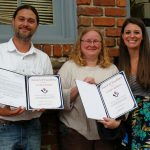 Megan Shelton (right), presents  Awards of Excellence to Zac and Jennifer