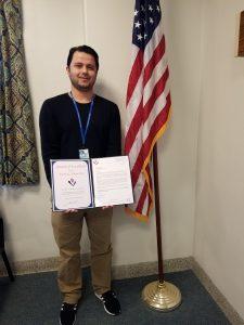 Parwaiz Ahmadzai presented with an  Award of Excellence.