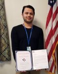 Parwaiz Ahmadzai presented with an  Award of Excellence.