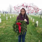 VMSI Program Manager,  Emily Wilson, laying wreaths
