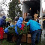 Volunteers handing out wreaths