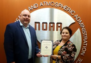 Ken Konkol, COO, presenting Pearl Chamberlin  with an Award of Excellence.