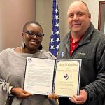 Mariama being presented with her  Award of Excellence by VMSI's Ken Konkol.