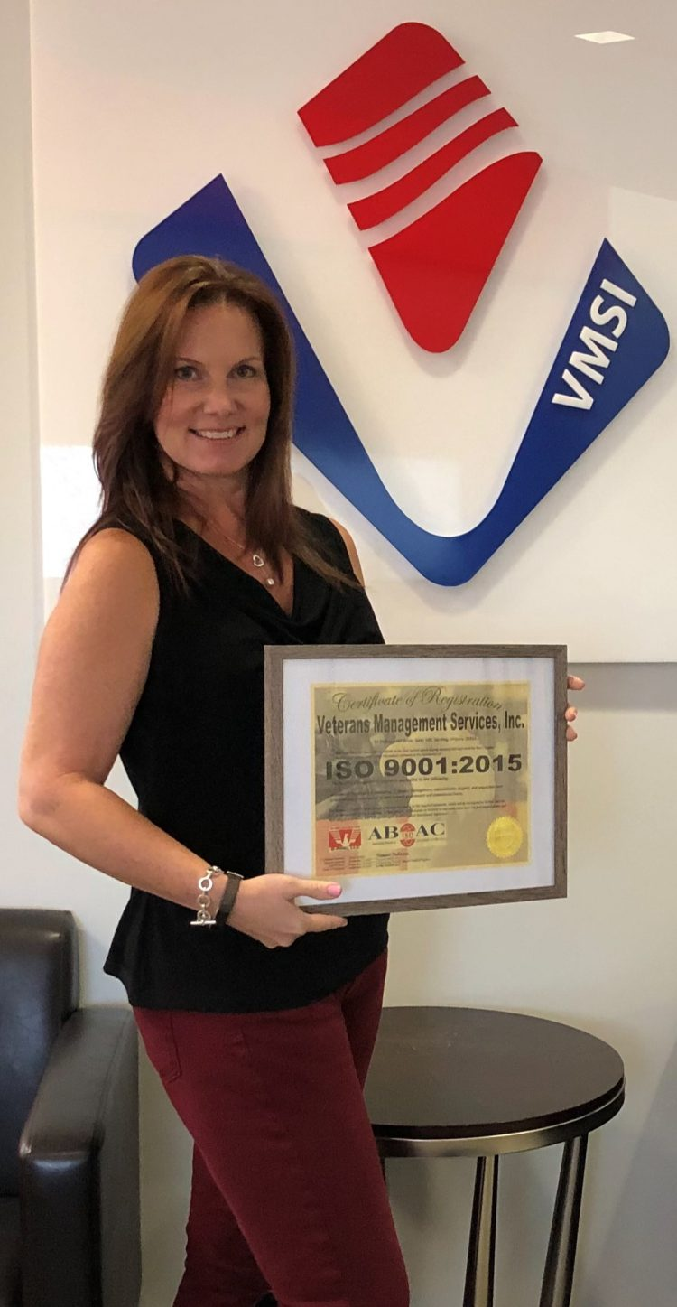 Paige Meade with VMSI's ISO 9001:2015 Certificate