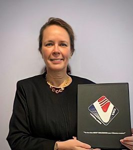 Carol Erwin with her Award of Excellence